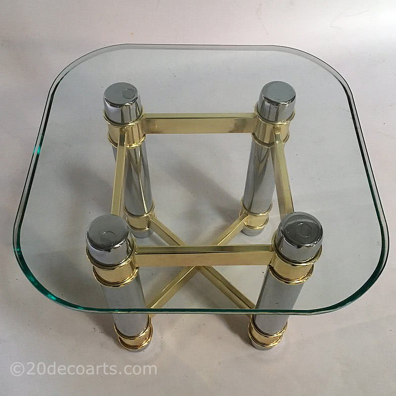 20th Century Decorative Arts |A side table, the glass top supported on a brass and chrome plated metal base, circa last quarter of the 20th century, very much in the Hollywood Regency style.