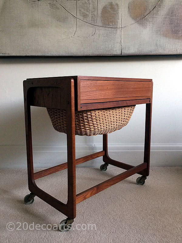 20th Century Decorative Arts | A mid-century modern design Danish sewing table in teak, single drawer partitioned inside in a light wood, above a slide out basket. c1960's.