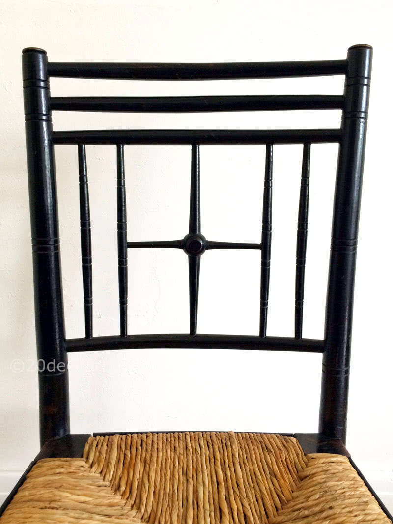 A set of 4 Liberty & Co ebonised and rush seated Argyll Chairs c1880. A classic design attributed to Ford Maddox Brown