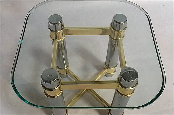 ☑️ 20th Century Decorative Arts |A side table, the glass top supported on a brass and chrome plated metal base