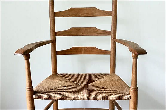 ☑️ 20th Century Decorative Arts |Edward Gardiner. A tall ladder back Clissett armchair in ash with original rush seat