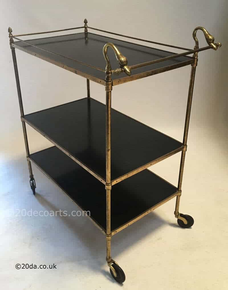 vintage brass framed 3 tier trolley with black laminated wooden shelves and swan handle c1950's