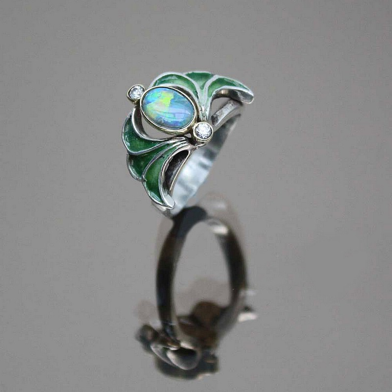 An Art Nouveau 925 silver, opal, gold coloured metal, enamel and old rose cut diamond ring  Germany circa 1900.