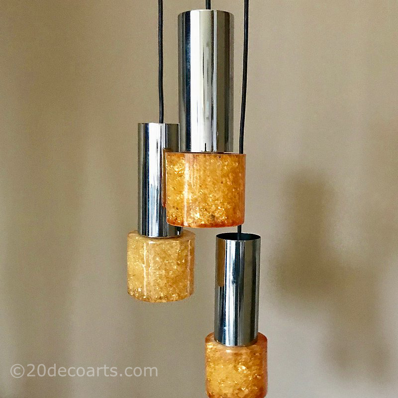 "A 1960's /70's Triple Pendant Ceiling Light In amber               resin ""Shatterline"" and chrome,"