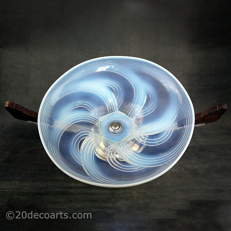 20th Century Decorative Arts |A beautiful Art Deco opalescent glass table centrepiece, 1930s, the glass probably by Cristallerie Choisy-le-Roi France, the polished glass molded with a stylised swirls, mounted on palisander wood and chromed metal
