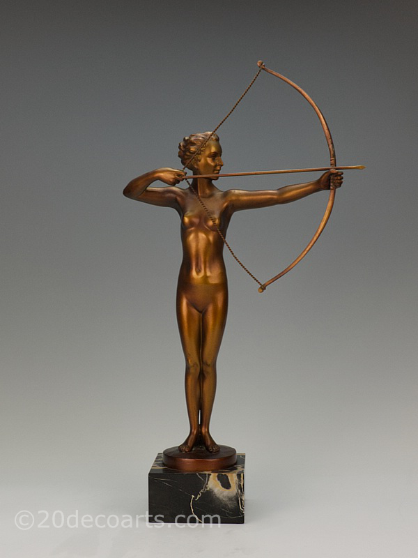 "20th Century Decorative Arts |A superb Art Deco German metal figure ""Diana"", with bronze bow and arrow, circa 1930s depicting the huntress with a copper/gold cold-painted and enamelled finish, mounted on a portoro marble base"