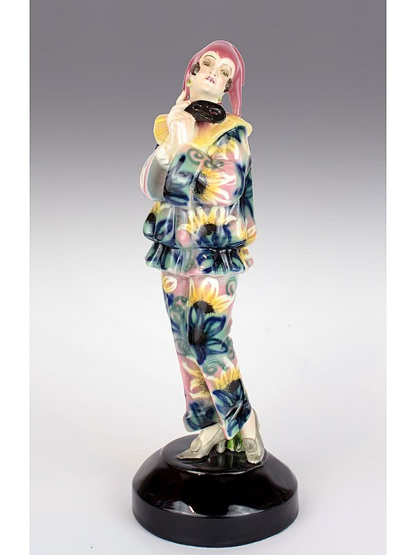 "20th Century Decorative Arts |A rare and stylish Art Deco figure by Lorenzl for Goldscheider, ""Pierrette mit Maske"" Vienna Austria c1925 - depicting a Pierrette in a stylish floral decorated outfit."