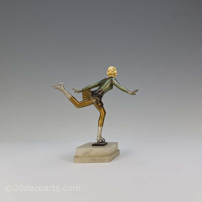 20th Century Decorative Arts |An Art Deco spelter and ivorine figure, Germany 1930s, the cold-painted figure mounted on a shaped alabaster base.