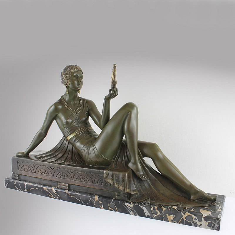 "20th Century Decorative Arts |An extremely rare Art Deco  patinated silvered and gilded bronze sculpture by Joseph Emmanuel Descomps  circa 1925 titled ""Comparison"", edited by Etling -Paris"