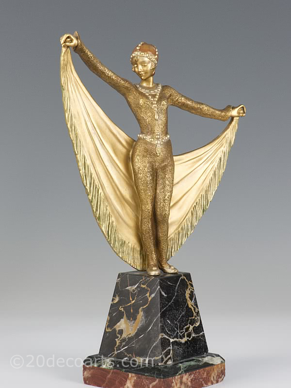 20th Century Decorative Arts |A rare Art Deco French bronze figure by Henri Désiré Grisard, circa 1925 depicting a cat-suited dancer with drape and a gilded and enamelled cold-painted finish, mounted on a shaped multi-marble base.