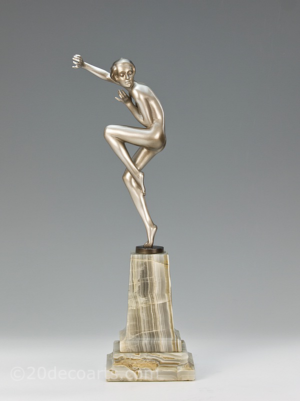 Josef Lorenzl - A fine Art Deco bronze figure, Vienna Austria circa 1930 depicting a silvered and lacquered dancing young woman