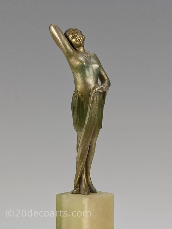 "20th Century Decorative Arts |An exquisite Art Deco Austrian bronze figure by Josef Lorenzl, circa 1930 ""Fashion"" depicting a stylish modern woman, with a silver, gold and enamelled cold-painted finish, mounted on a green onyx base"