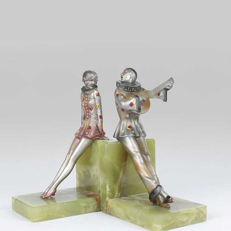 20th Century Decorative Arts |Rare Art Deco Austrian bronze bookends by Josef Lorenzl, the figures with enamelling by Crejo circa 1920s, depicting Pierrette and Pierrot,