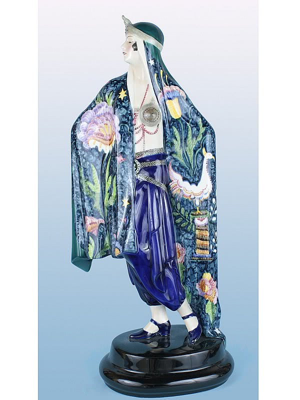 "20th Century Decorative Arts |An Art Deco ceramic figurine by Lorenzl for Goldscheider  ""Aida"" circa 1923/4, Vienna Austria,  depicting an odalisque wearing a beautifully decorated robe-"
