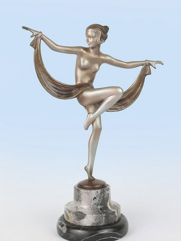 An exquisite Art Deco Austrian bronze figure by Josef Lorenzl, circa 1930 depicting a dancing woman with drape, with cold-painted silver finish, mounted on a shaped marble base
