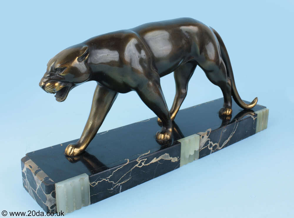 Ruchot - An Art Deco metal patinated panther sculpture, France circa 1930, mounted on a marble and onyx base.