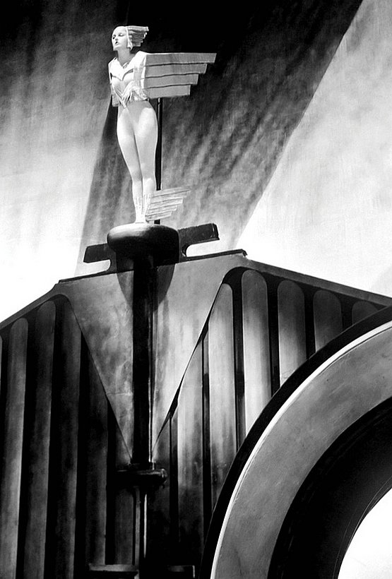 Corinne Griffith costumed as an Art Deco-style Rolls Royce ornament in Lilies of the Field (1924, Art direction by Milton Menasco