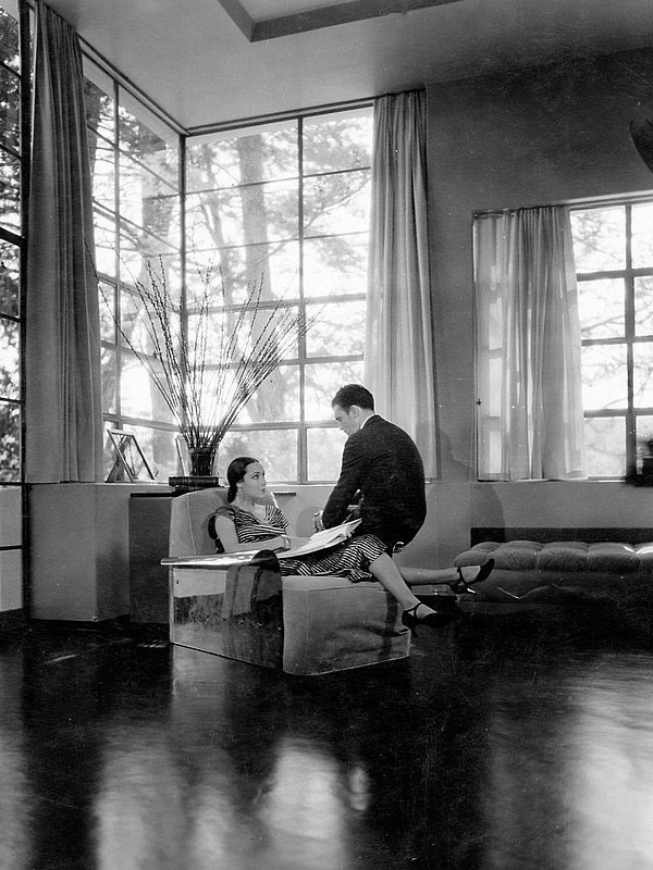 Dolores Del Rio and Cedric Gibbons in their home.
